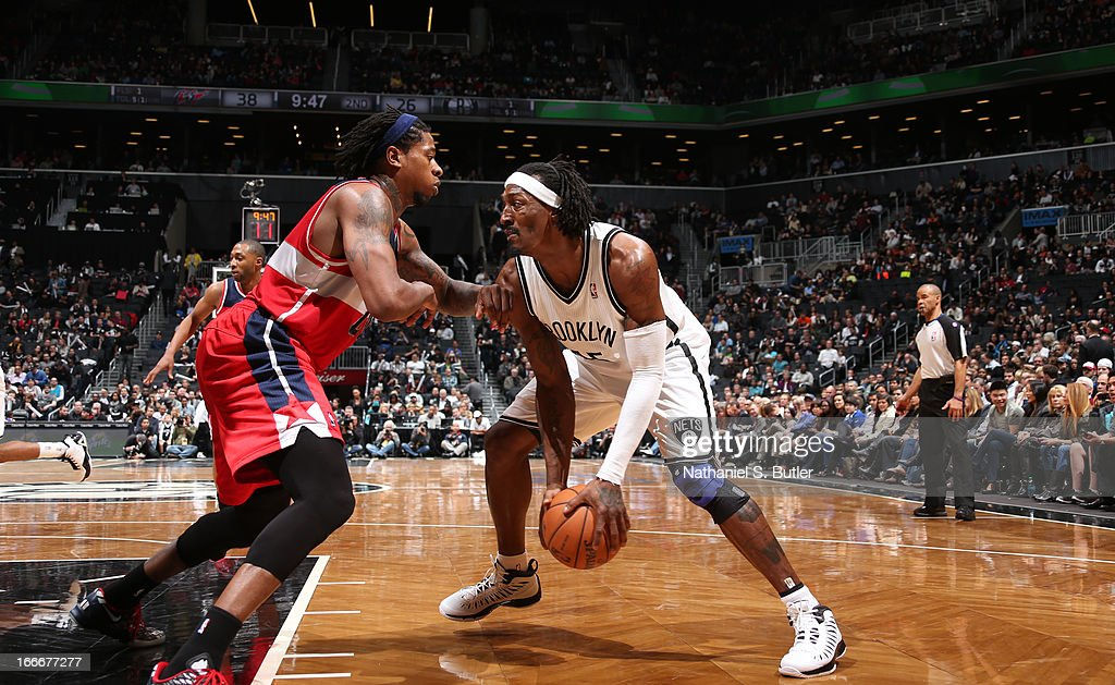 Gerald Wallace #45 of the Brooklyn Nets dribbles against Cartier Martin #20 of the Washington Wizards on April 15, 2013 at the Barclays Center in the Brooklyn borough of New York City.