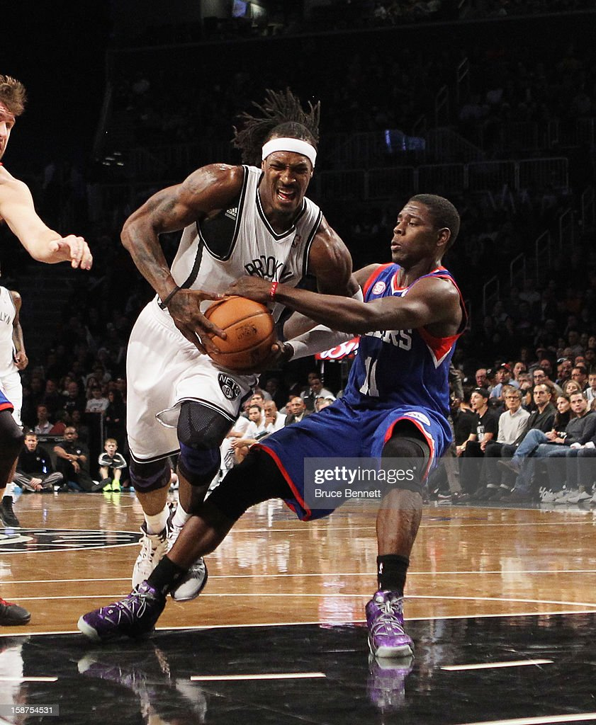 Gerald Wallace #45 of the Brooklyn Nets dribbles through Jrue Holiday #11 of the Philadelphia 76ers at Barclays Center on December 23, 2012 in the Brooklyn borough of New York City.
