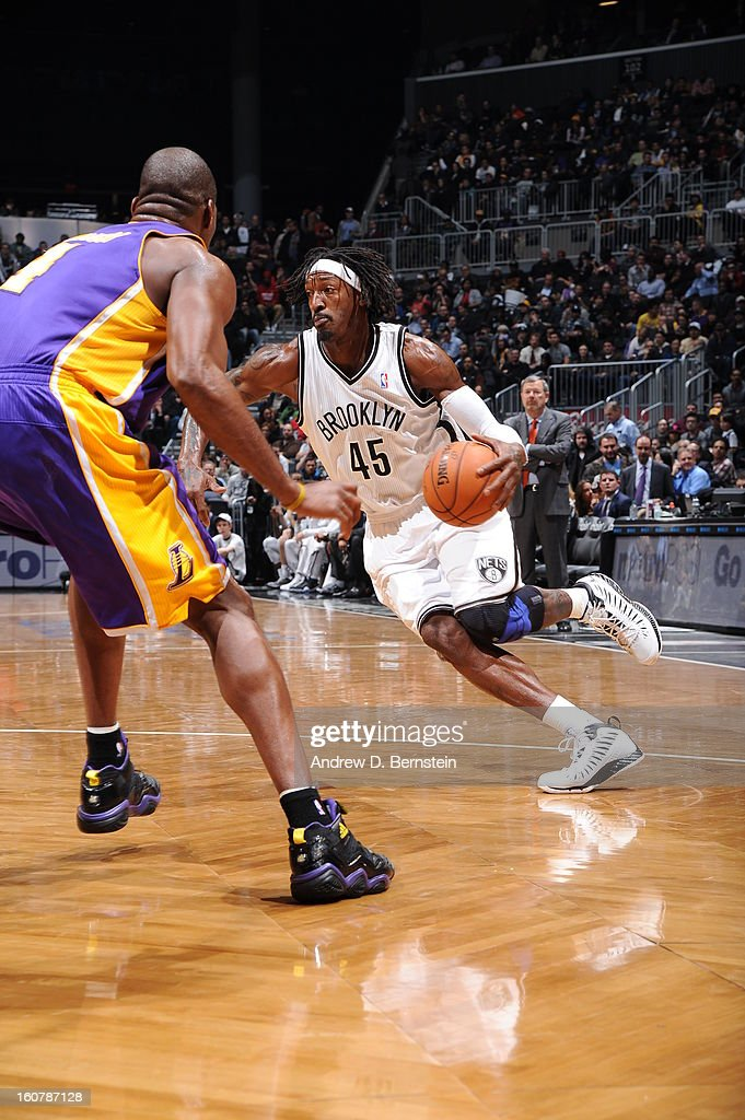 Gerald Wallace #45 of the Brooklyn Nets drives against Antawn Jamison #4 of the Los Angeles Lakers on February 5, 2013 at the Barclays Center in the Brooklyn borough of New York City.
