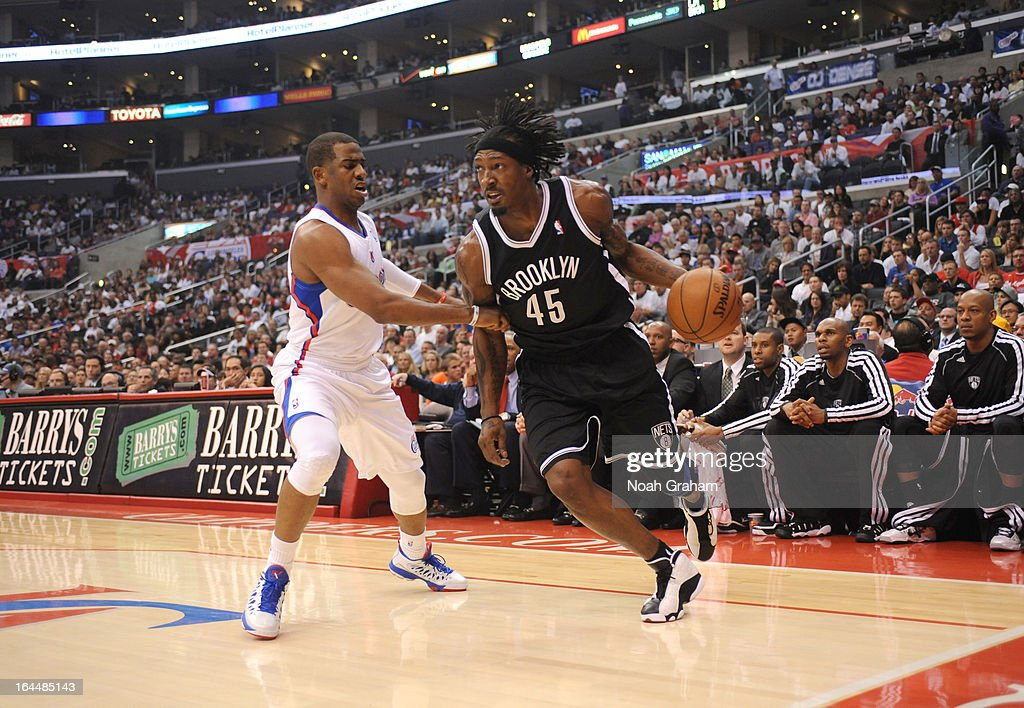 Gerald Wallace #45 of the Brooklyn Nets drives against Chris Paul #3 of the Los Angeles Clippers during the game between the Los Angeles Clippers and the Brooklyn Nets at Staples Center on March 23, 2013 in Los Angeles, California.