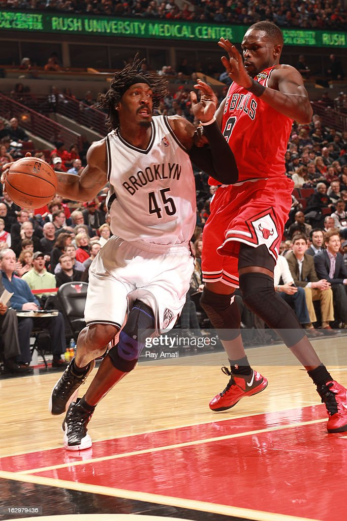 Gerald Wallace #45 of the Brooklyn Nets drives against Luol Deng #9 of the Chicago Bulls on March 2, 2013 at the United Center in Chicago, Illinois.