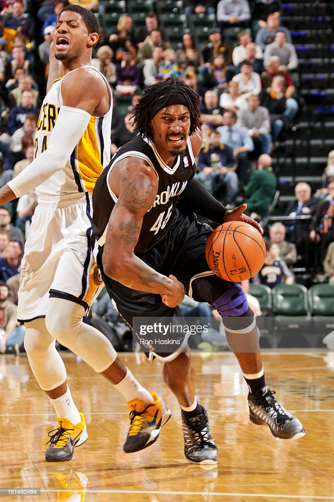 Gerald Wallace #45 of the Brooklyn Nets drives ahead of Paul George #24 of the Indiana Pacers on February 11, 2013 at Bankers Life Fieldhouse in Indianapolis, Indiana.