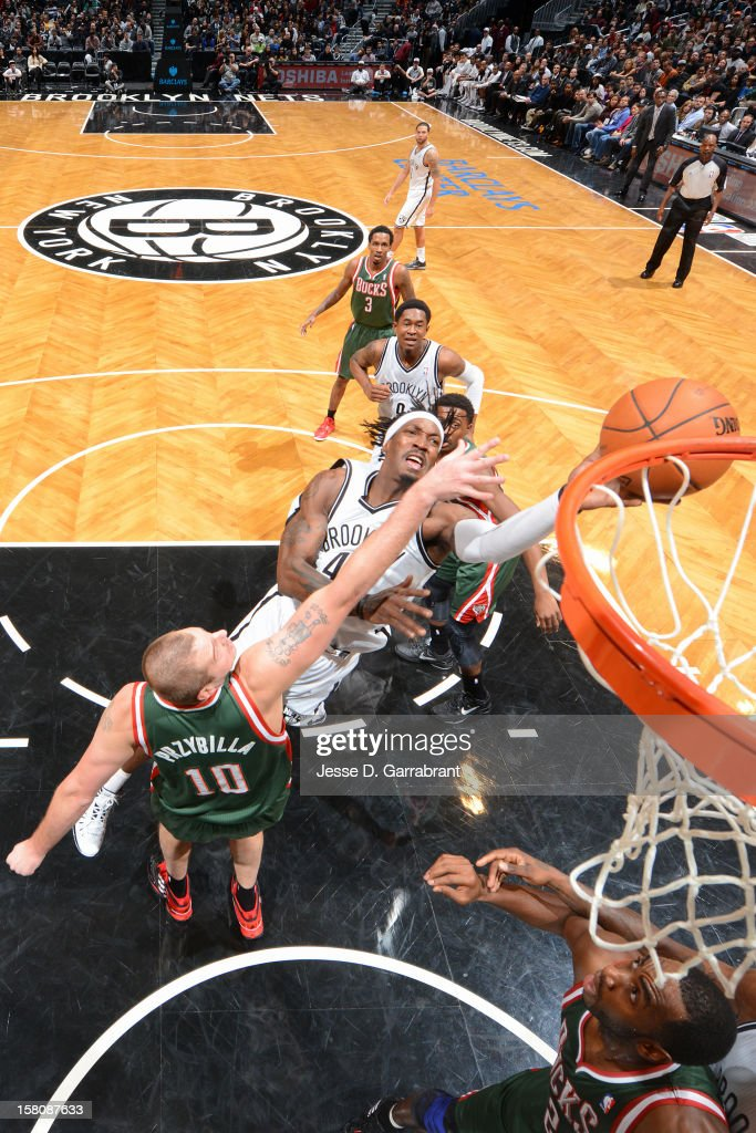 <a gi-track='captionPersonalityLinkClicked' href=/galleries/search?phrase=Gerald+Wallace&family=editorial&specificpeople=202117 ng-click='$event.stopPropagation()'>Gerald Wallace</a> #45 of the Brooklyn Nets drives to the basket against <a gi-track='captionPersonalityLinkClicked' href=/galleries/search?phrase=Joel+Przybilla&family=editorial&specificpeople=202050 ng-click='$event.stopPropagation()'>Joel Przybilla</a> #10 of the Milwaukee Bucks on December 9, 2012 at the Barclays Center in Brooklyn, New York.