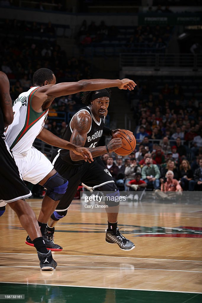 Gerald Wallace #45 of the Brooklyn Nets drives to the basket against Luc Richard Mbah a Moute #12 of the Milwaukee Bucks during the NBA game on December 26, 2012 at the BMO Harris Bradley Center in Milwaukee, Wisconsin.