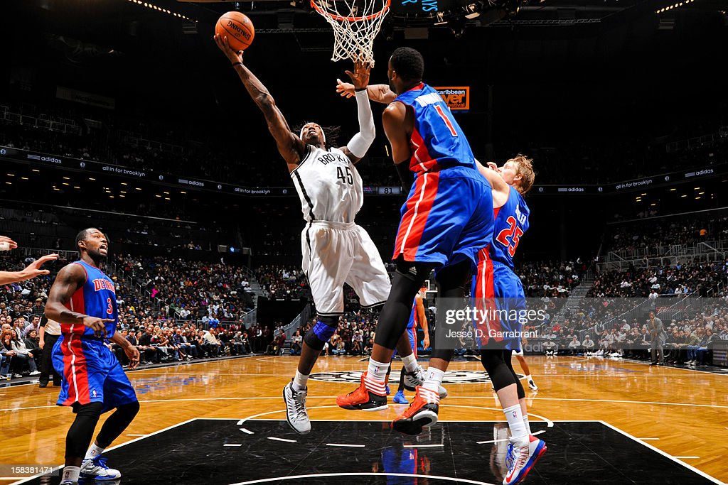 Gerald Wallace #45 of the Brooklyn Nets drives to the basket against Andre Drummond #1 of the Detroit Pistons at the Barclays Center on December 14, 2012 in the Brooklyn borough of New York City.