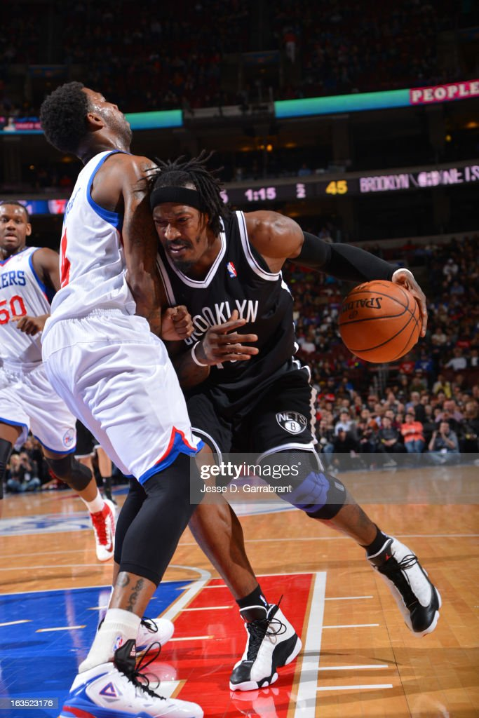 Gerald Wallace #45 of the Brooklyn Nets drives to the basket against Dorell Wright #4 of the Philadelphia 76ers at the Wells Fargo Center on March 11, 2013 in Philadelphia, Pennsylvania.