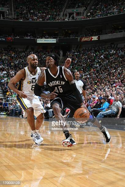 Gerald Wallace of the Brooklyn Nets drives to the basket against Jamaal Tinsley of the Utah Jazz at Energy Solutions Arena on March 30 2013 in Salt...