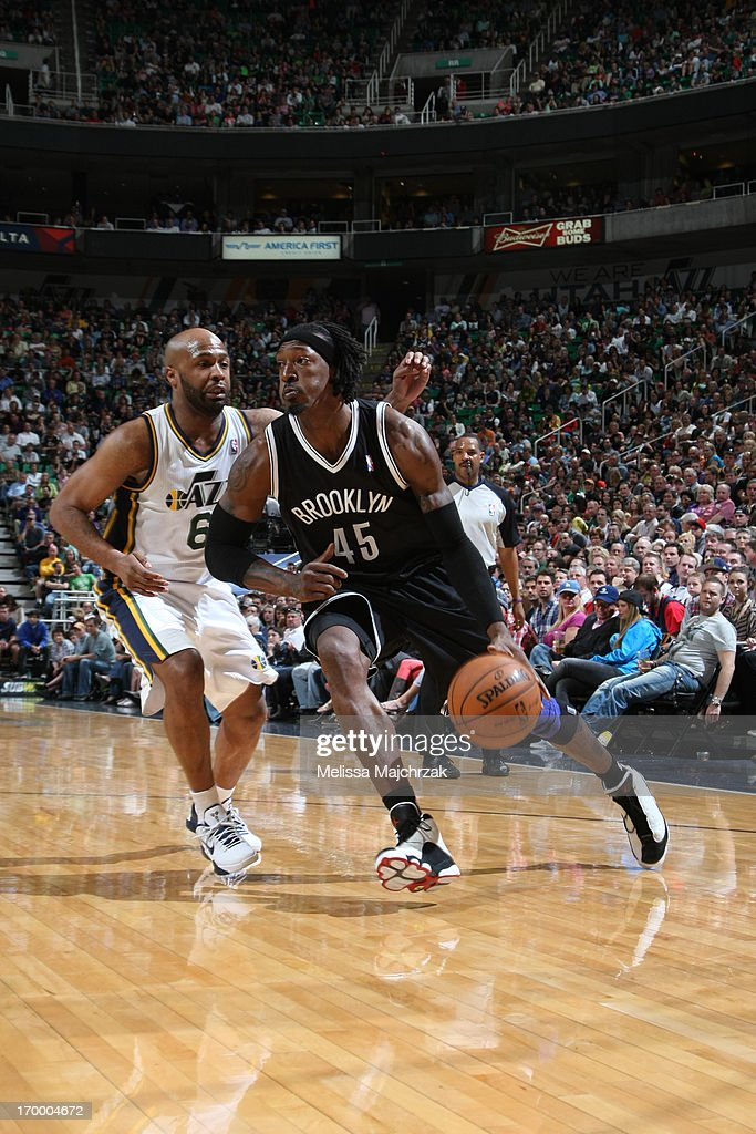 <a gi-track='captionPersonalityLinkClicked' href=/galleries/search?phrase=Gerald+Wallace&family=editorial&specificpeople=202117 ng-click='$event.stopPropagation()'>Gerald Wallace</a> #45 of the Brooklyn Nets drives to the basket against <a gi-track='captionPersonalityLinkClicked' href=/galleries/search?phrase=Jamaal+Tinsley&family=editorial&specificpeople=202203 ng-click='$event.stopPropagation()'>Jamaal Tinsley</a> #6 of the Utah Jazz at Energy Solutions Arena on March 30, 2013 in Salt Lake City, Utah.
