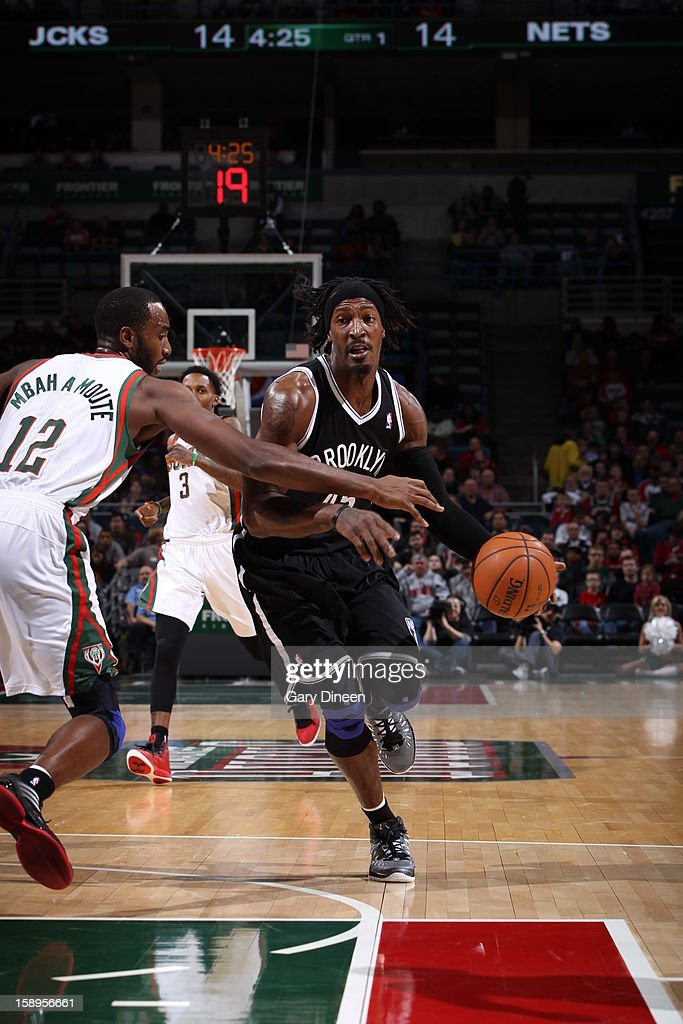 <a gi-track='captionPersonalityLinkClicked' href=/galleries/search?phrase=Gerald+Wallace&family=editorial&specificpeople=202117 ng-click='$event.stopPropagation()'>Gerald Wallace</a> #45 of the Brooklyn Nets drives to the basket against the Milwaukee Bucks on December 26, 2012 at the BMO Harris Bradley Center in Milwaukee, Wisconsin.