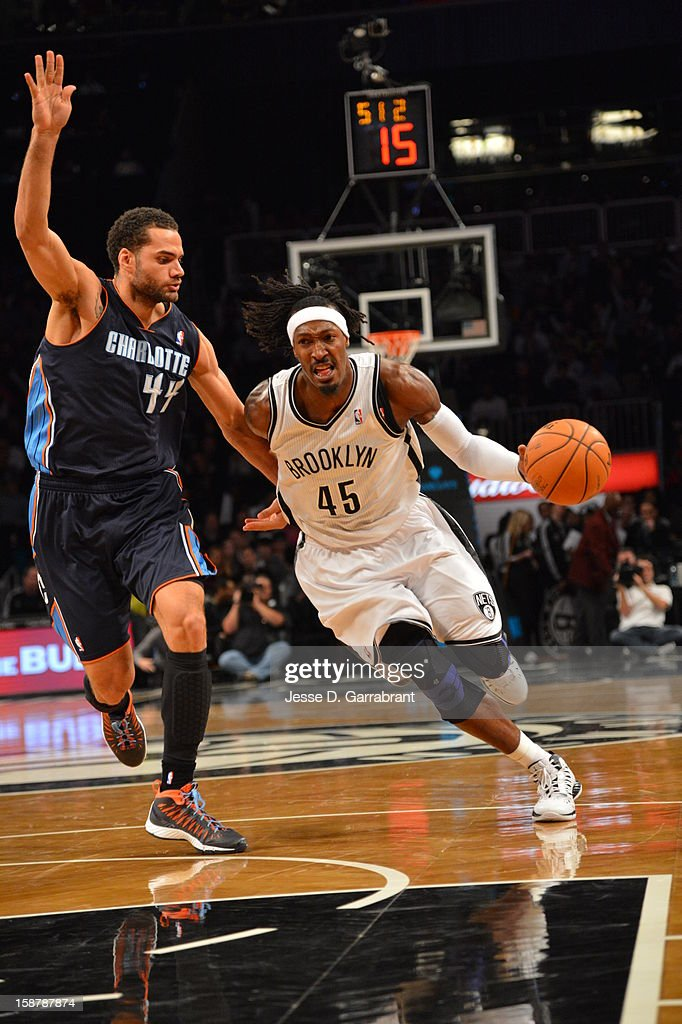 Gerald Wallace #45 of the Brooklyn Nets drives to the basket around Jeffery Taylor #44 of the Charlotte Bobcats at the Barclays Center on December 28, 2012 in Brooklyn, New York.