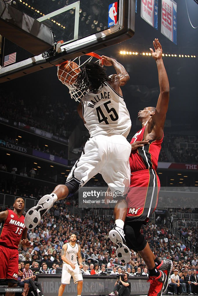 Gerald Wallace #45 of the Brooklyn Nets dunks against Chris Bosh #1 of the Miami Heat on January 30, 2013 at the Barclays Center in the Brooklyn borough of New York City.