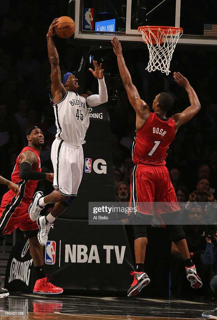 Gerald Wallace #45 of the Brooklyn Nets dunks against Chris Bosh #1 of the Miami Heat during their game at the Barclays Center on January 30, 2013 in the Brooklyn borough of New York City.
