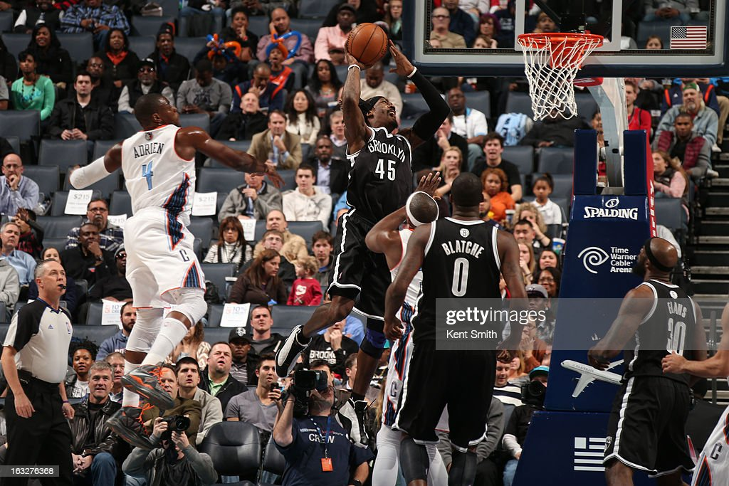 Gerald Wallace #45 of the Brooklyn Nets dunks against Jeff Adrien #4 and the Charlotte Bobcats at the Time Warner Cable Arena on March 6, 2013 in Charlotte, North Carolina.