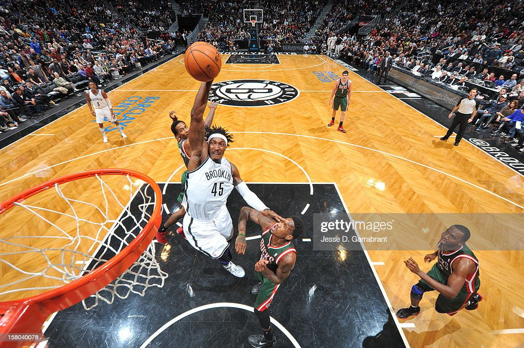 Gerald Wallace #45 of the Brooklyn Nets dunks against Larry Sanders #8 of the Milwaukee Bucks during the game at the Barclays Center on December 9, 2012 in Brooklyn, New York.