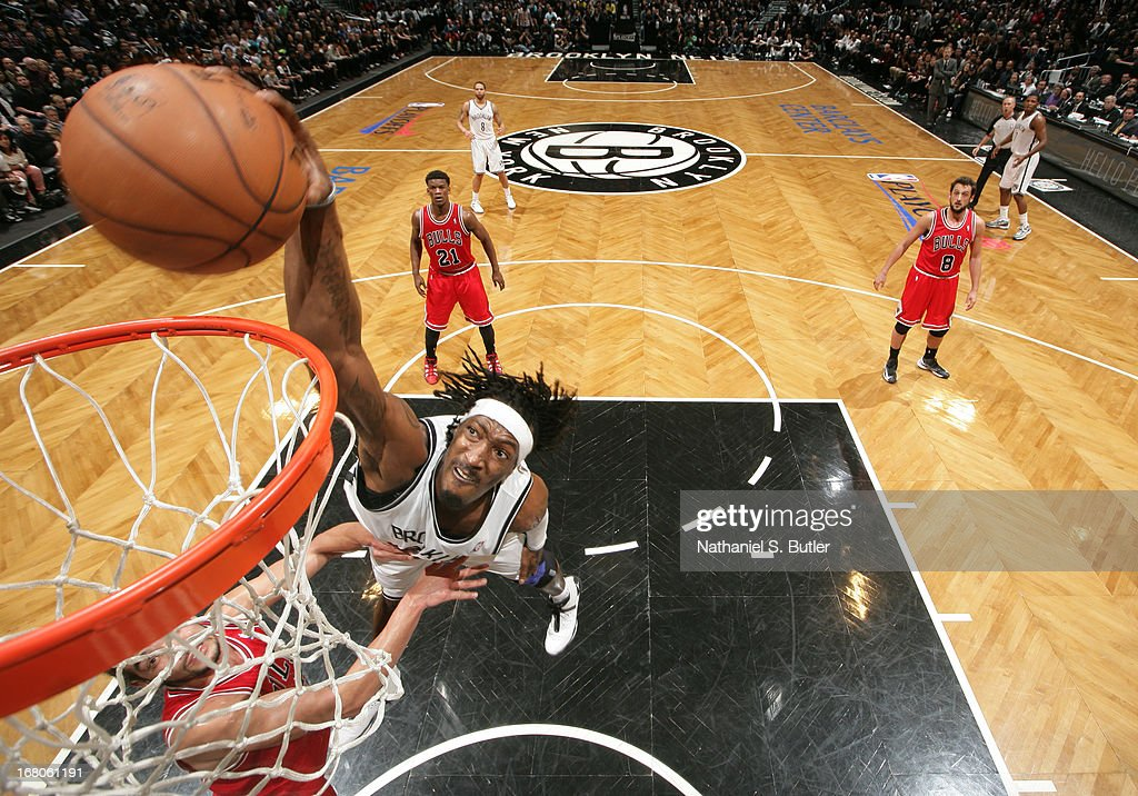 Gerald Wallace #45 of the Brooklyn Nets dunks past Joakim Noah #13 of the Chicago Bulls during the Game Seven of the Eastern Conference Quarterfinals during the 2013 NBA Playoffs at the Barclays Center on May 4, 2013 in the Brooklyn borough of New York City.