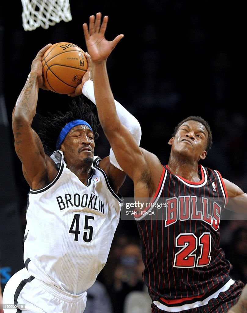 Gerald Wallace (L) of the Brooklyn Nets fights for a rebound against Jimmy Butler (R) of the Chicago Bulls during game at the Barclay Center February 1, 2013 in the Brooklyn borough of New York. The Nets won, 93-89. AFP PHOTO/Stan HONDA