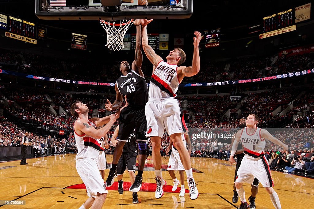 Gerald Wallace #45 of the Brooklyn Nets fights for a rebound against Meyers Leonard #11 of the Portland Trail Blazers on March 27, 2013 at the Rose Garden Arena in Portland, Oregon.