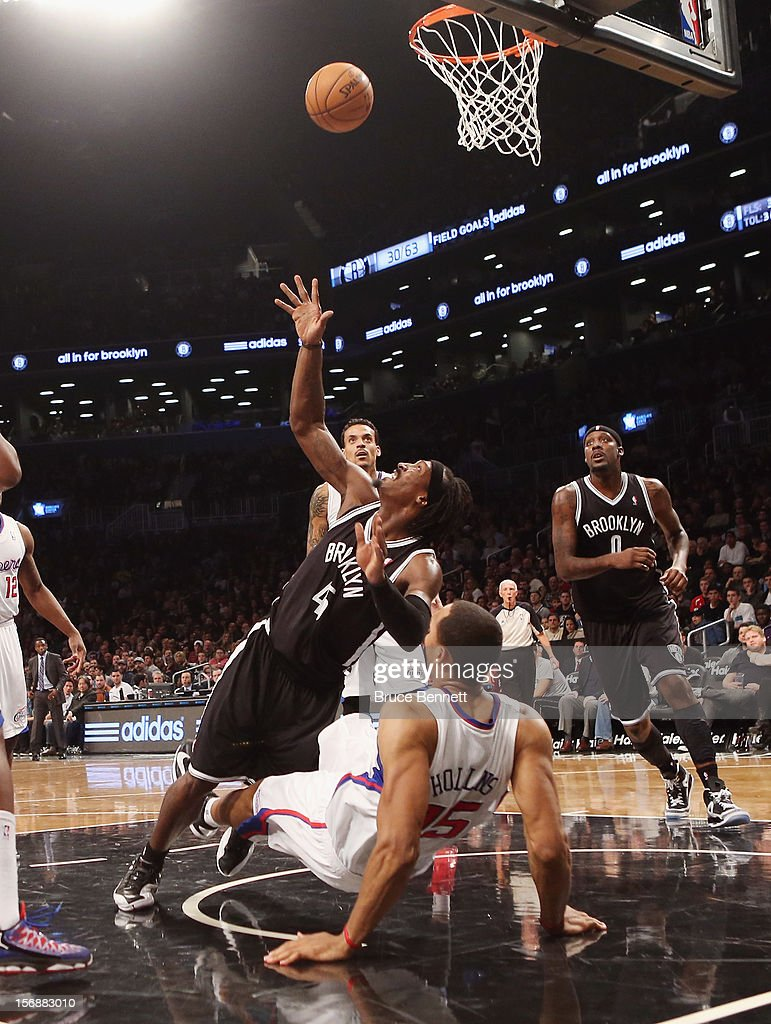 Gerald Wallace #45 of the Brooklyn Nets fouls Ryan Hollins #15 of the Los Angeles Clippers in the fourth quarter at the Barclays Center on November 23, 2012 in the Brooklyn borough of New York City.