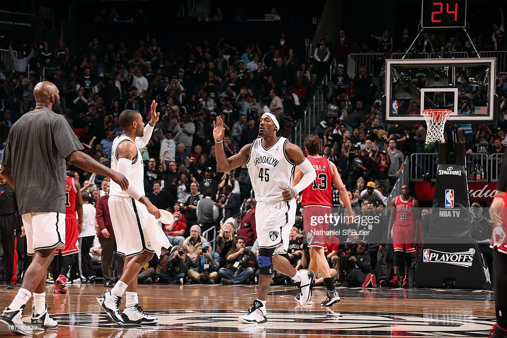 Gerald Wallace #45 of the Brooklyn Nets gives high-fives while coming out of the game against the Chicago Bulls in Game Five of the Eastern Conference Quarterfinals during the 2013 NBA Playoffs on April 29 at the Barclays Center in the Brooklyn borough of New York City.