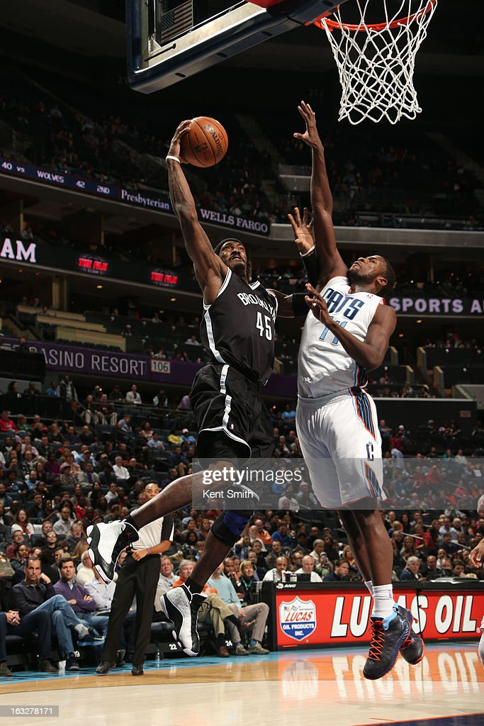 Gerald Wallace #45 of the Brooklyn Nets goes to the basket against Michael Kidd-Gilchrist #14 of the Charlotte Bobcats at the Time Warner Cable Arena on March 6, 2013 in Charlotte, North Carolina.