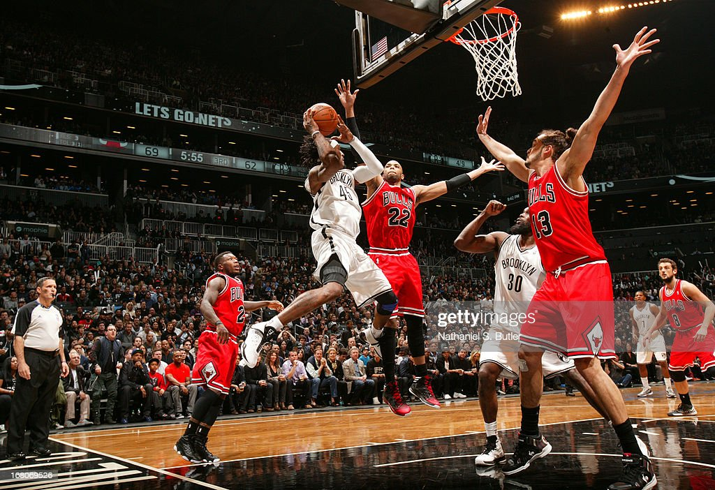 Gerald Wallace #45 of the Brooklyn Nets goes to the basket against Taj Gibson #22 of the Chicago Bulls during the Game Seven of the Eastern Conference Quarterfinals between the Chicago Bulls and the Brooklyn Nets during the 2013 NBA Playoffs at the Barclays Center on May 4, 2013 in the Brooklyn borough of New York City.