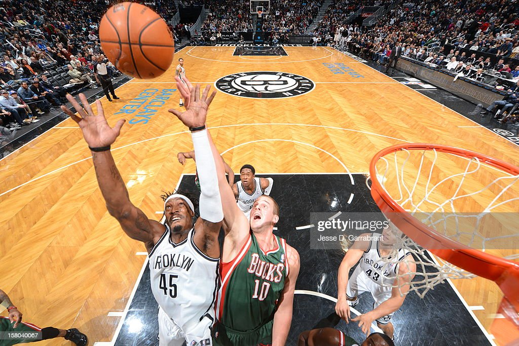 Gerald Wallace #45 of the Brooklyn Nets goes up for a rebound against Joel Przybilla #10 of the Milwaukee Bucks during the game at the Barclays Center on December 9, 2012 in Brooklyn, New York.