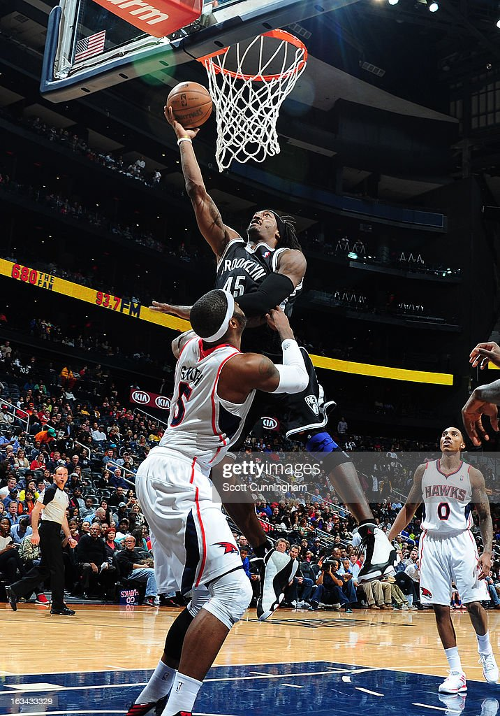 Gerald Wallace #45 of the Brooklyn Nets goes up for the bucket against the Atlanta Hawks on March 9, 2013 at Philips Arena in Atlanta, Georgia.