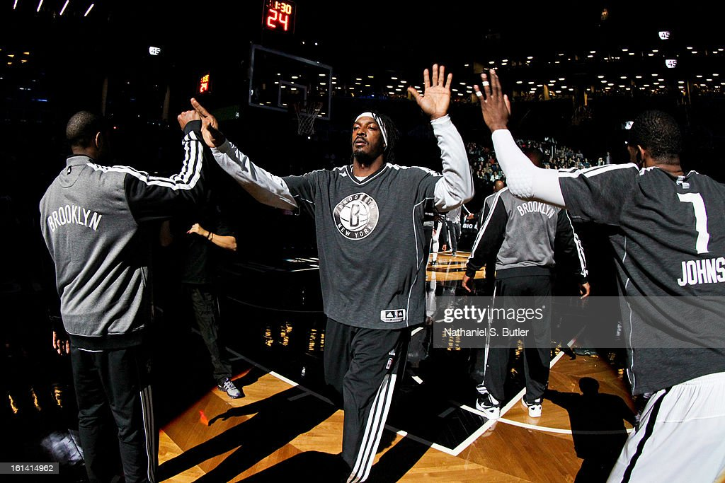 Gerald Wallace #45 of the Brooklyn Nets greets teammates before playing against the San Antonio Spurs on February 10, 2013 at the Barclays Center in the Brooklyn borough of New York City.