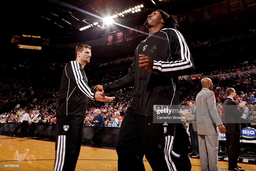 Gerald Wallace #45 of the Brooklyn Nets greets teammates before playing against the Portland Trail Blazers on March 27, 2013 at the Rose Garden Arena in Portland, Oregon.