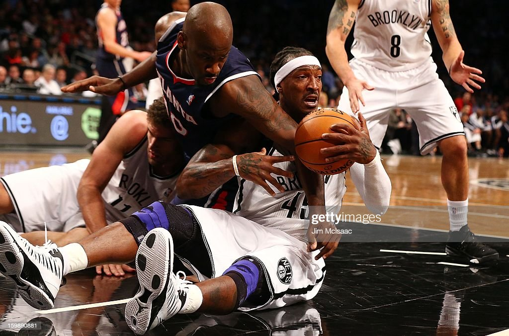 Gerald Wallace #45 of the Brooklyn Nets in action against Johan Petro #10 of the Atlanta Hawks at Barclays Center on January 18, 2013 in the Brooklyn borough of New York City.The Nets defeated the Hawks 94-89.