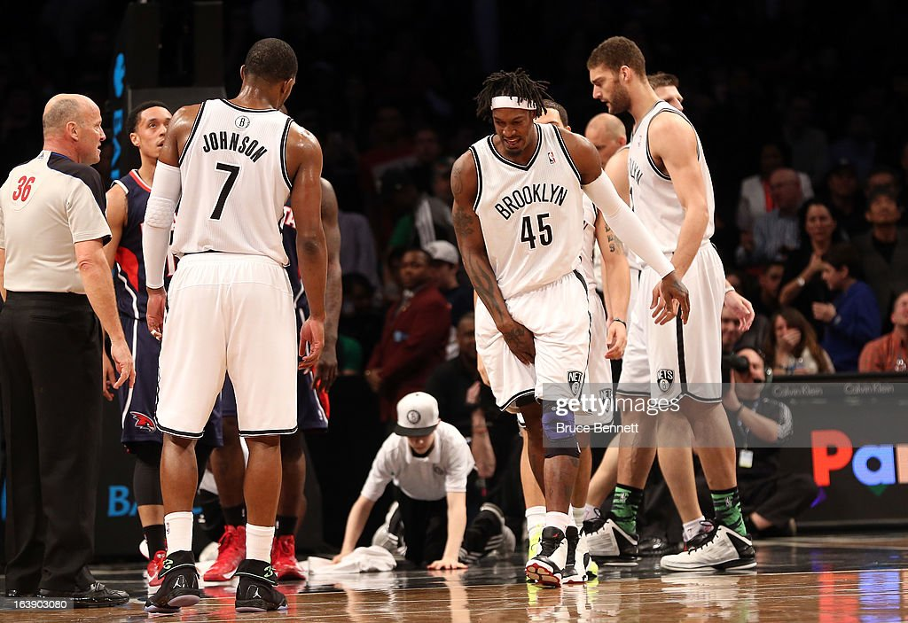 Gerald Wallace #45 of the Brooklyn Nets is injured in a fall during the second quarter against the Atlanta Hawks at the Barclays Center on March 17, 2013 in New York City.