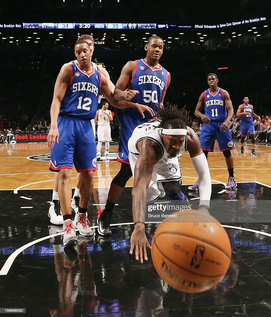 Gerald Wallace #45 of the Brooklyn Nets is tripped up in the game against the Philadelphia 76ers at Barclays Center on December 23, 2012 in the Brooklyn borough of New York City.