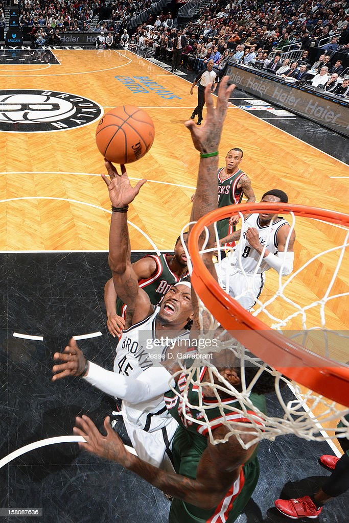<a gi-track='captionPersonalityLinkClicked' href=/galleries/search?phrase=Gerald+Wallace&family=editorial&specificpeople=202117 ng-click='$event.stopPropagation()'>Gerald Wallace</a> #45 of the Brooklyn Nets lays it up against the Milwaukee Bucks on December 9, 2012 at the Barclays Center in Brooklyn, New York.