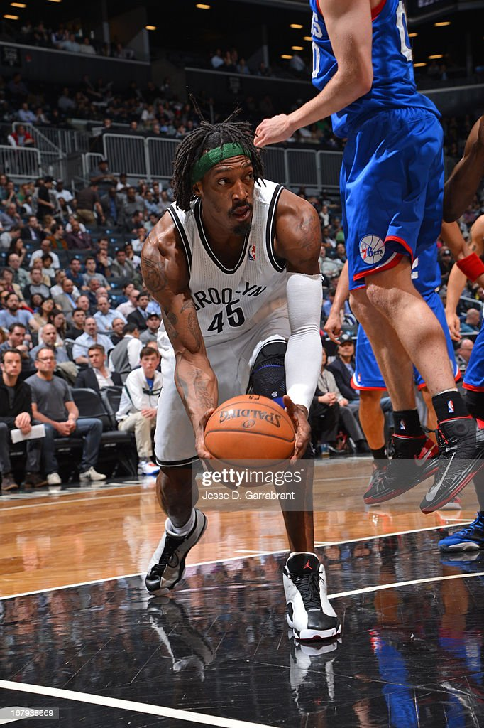 <a gi-track='captionPersonalityLinkClicked' href=/galleries/search?phrase=Gerald+Wallace&family=editorial&specificpeople=202117 ng-click='$event.stopPropagation()'>Gerald Wallace</a> #45 of the Brooklyn Nets looks to pass the ball against the Philadelphia 76ers on April 9, 2013 at the Barclays Center in Brooklyn, New York.