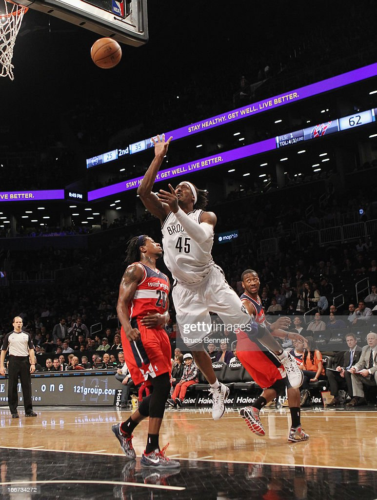Gerald Wallace #45 of the Brooklyn Nets scores two in the third and is fouled against the Washington Wizards at the Barclays Center on April 15, 2013 in New York City. The Nets defeated the Washington Wizards 106-101.