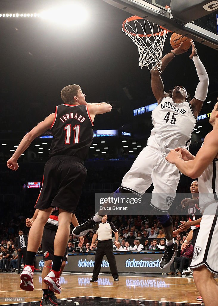 <a gi-track='captionPersonalityLinkClicked' href=/galleries/search?phrase=Gerald+Wallace&family=editorial&specificpeople=202117 ng-click='$event.stopPropagation()'>Gerald Wallace</a> #45 of the Brooklyn Nets scores two late in the fourth quarter against the Portland Trail Blazers at the Barclays Center on November 25, 2012 in the Brooklyn borough of New York City.