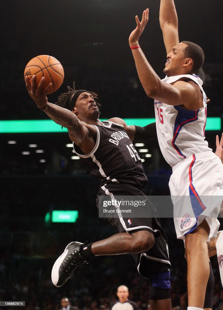 Gerald Wallace #45 of the Brooklyn Nets scores two past Ryan Hollins #15 of the Los Angeles Clippers in the fourth quarter at the Barclays Center on November 23, 2012 in the Brooklyn borough of New York City.