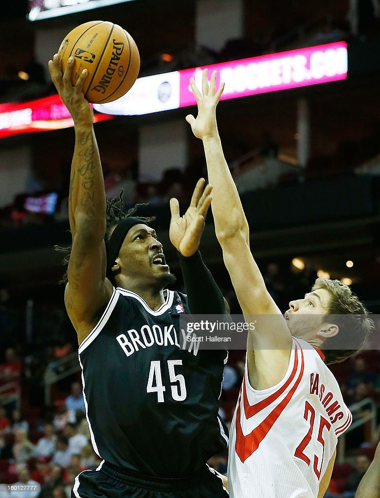 Gerald Wallace #45 of the Brooklyn Nets shoot the ball over Chandler Parsons #25 of the Houston Rockets at Toyota Center on January 26, 2013 in Houston, Texas.