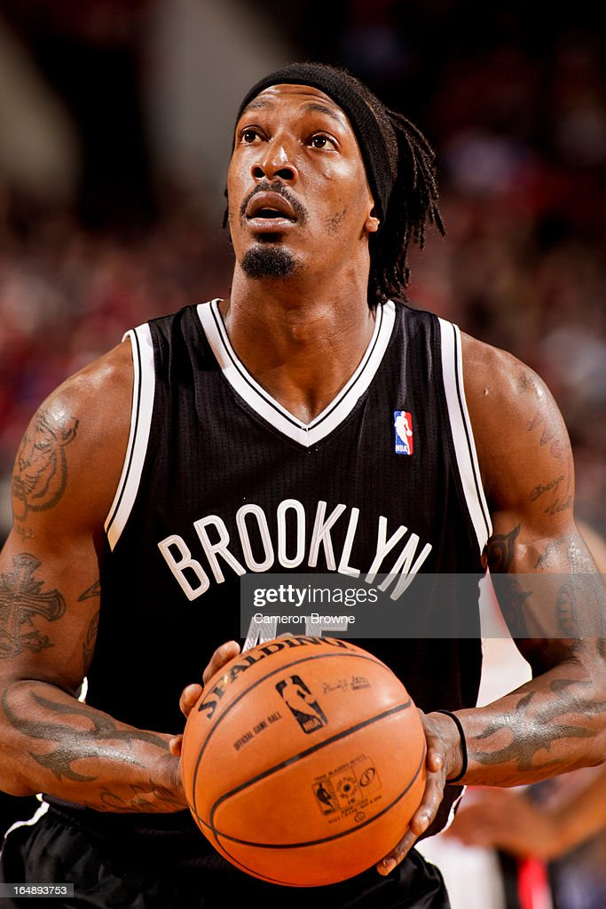 Gerald Wallace #45 of the Brooklyn Nets shoots a free-throw against the Portland Trail Blazers on March 27, 2013 at the Rose Garden Arena in Portland, Oregon.