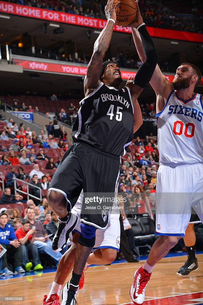 Gerald Wallace #45 of the Brooklyn Nets shoots a layup against Spencer Hawes #00 of the Philadelphia 76ers at the Wells Fargo Center on March 11, 2013 in Philadelphia, Pennsylvania.