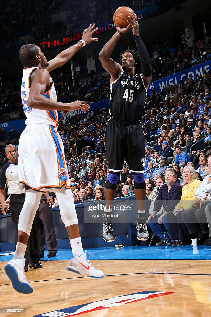 Gerald Wallace #45 of the Brooklyn Nets shoots a three-pointer against Kevin Durant #35 of the Oklahoma City Thunder on January 2, 2013 at the Chesapeake Energy Arena in Oklahoma City, Oklahoma.