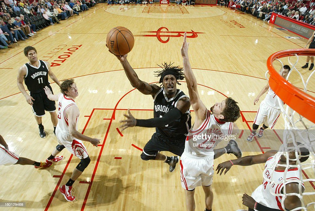Gerald Wallace #45 of the Brooklyn Nets shoots against Chandler Parsons #25 of the Houston Rockets on January 26, 2013 at the Toyota Center in Houston, Texas.