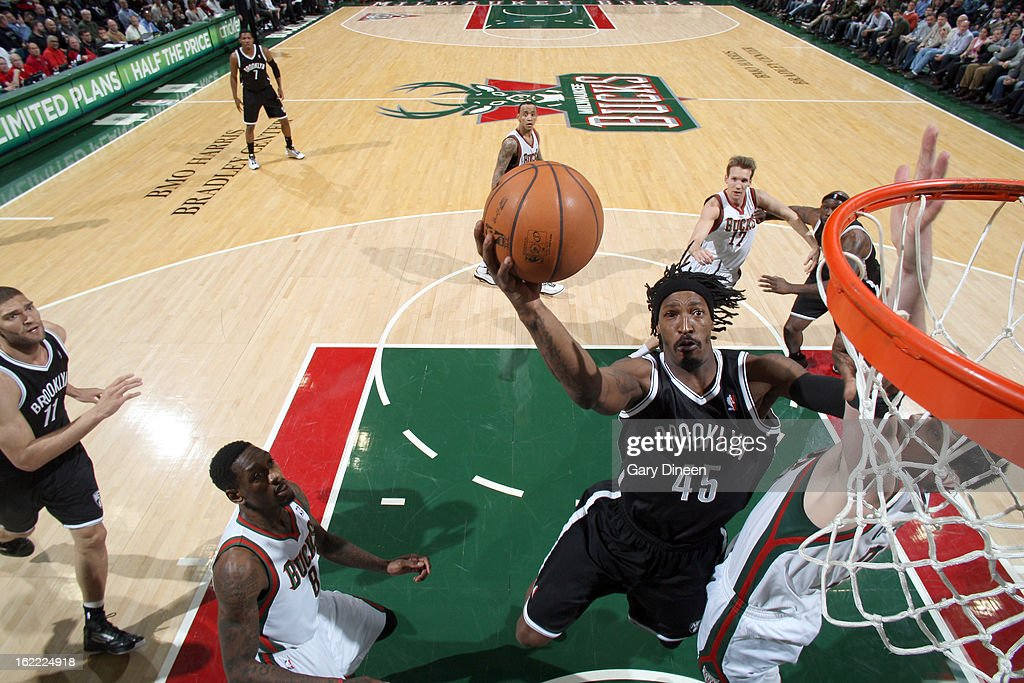 <a gi-track='captionPersonalityLinkClicked' href=/galleries/search?phrase=Gerald+Wallace&family=editorial&specificpeople=202117 ng-click='$event.stopPropagation()'>Gerald Wallace</a> #45 of the Brooklyn Nets shoots against <a gi-track='captionPersonalityLinkClicked' href=/galleries/search?phrase=Ersan+Ilyasova&family=editorial&specificpeople=557070 ng-click='$event.stopPropagation()'>Ersan Ilyasova</a> #7 of the Milwaukee Bucks on February 20, 2013 at the BMO Harris Bradley Center in Milwaukee, Wisconsin.