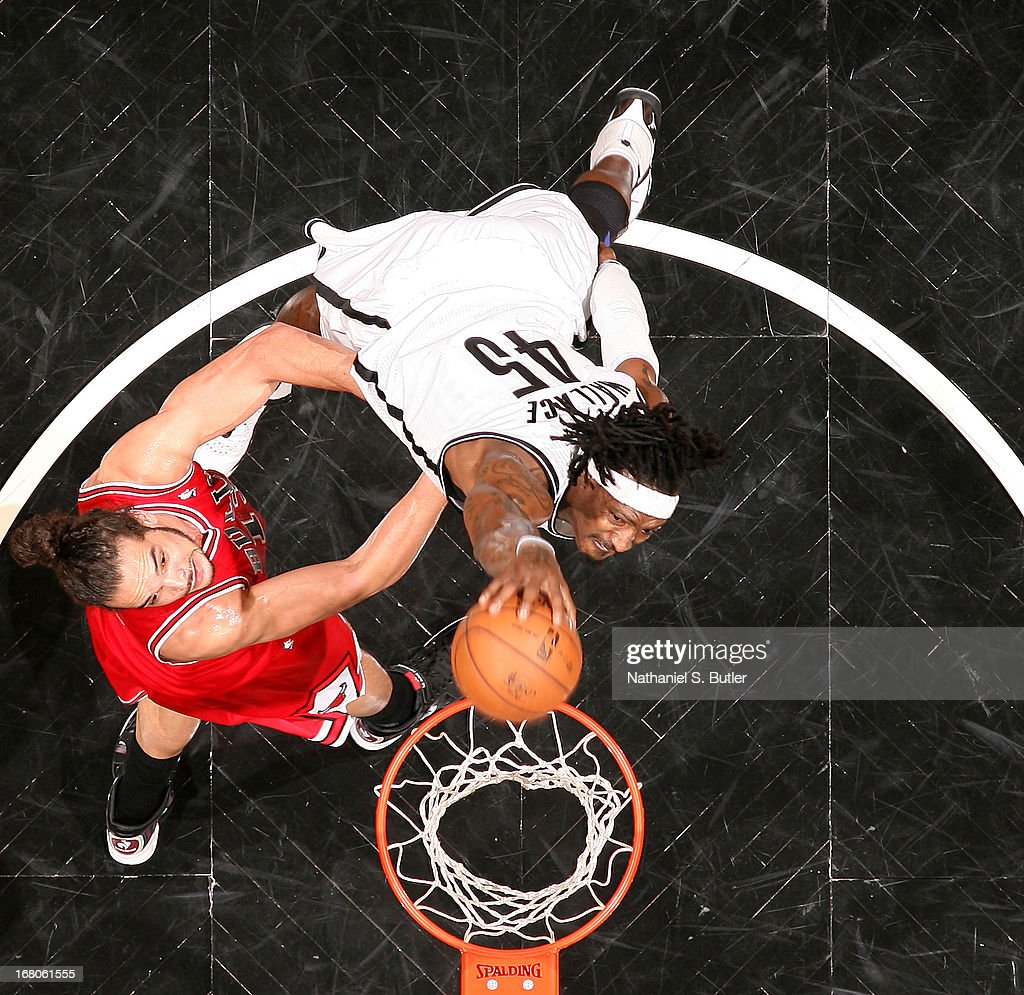 Gerald Wallace #45 of the Brooklyn Nets shoots against Joakim Noah #13 of the Chicago Bulls during Game Seven of the Eastern Conference Quarterfinals during the 2013 NBA Playoffs at the Barclays Center on May 4, 2013 in the Brooklyn borough of New York City.