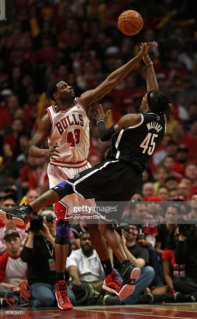 Gerald Wallace #45 of the Brooklyn Nets shoots against Nazr Mohammed #48 of the Chicago Bulls in Game Five of the Eastern Conference Quarterfinals in the 2013 NBA Playoffs at the United Center on April 27, 2013 in Chicago, Illinois. The Bulls defeated the Nets 142-134 in triple overtime.