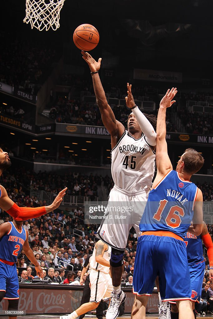 Gerald Wallace #45 of the Brooklyn Nets shoots against Steve Novak #16 of the New York Knicks December 11, 2012 at the Barclays Center in the Brooklyn borough of New York City.