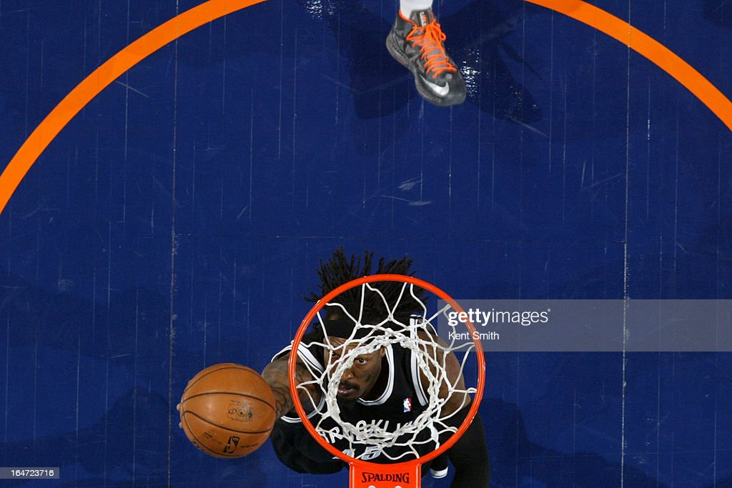 <a gi-track='captionPersonalityLinkClicked' href=/galleries/search?phrase=Gerald+Wallace&family=editorial&specificpeople=202117 ng-click='$event.stopPropagation()'>Gerald Wallace</a> #45 of the Brooklyn Nets shoots against the Charlotte Bobcats at the Time Warner Cable Arena on March 6, 2013 in Charlotte, North Carolina.
