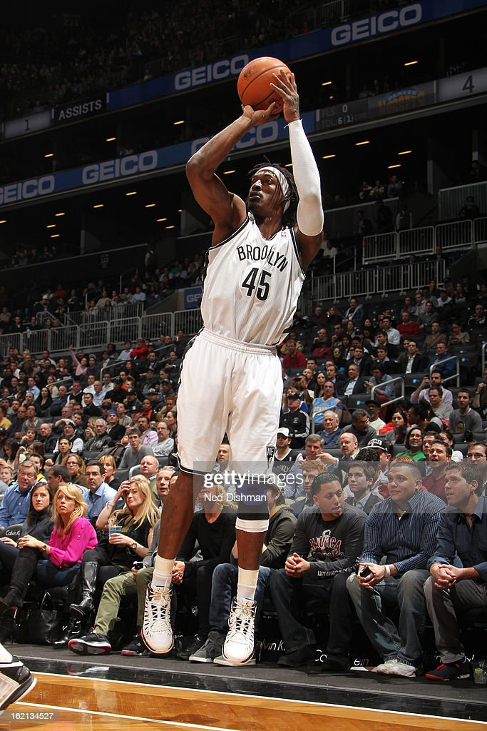 Gerald Wallace #45 of the Brooklyn Nets shoots against the Denver Nuggets on February 13, 2013 at the Barclays Center in the Brooklyn borough of New York City in New York City.