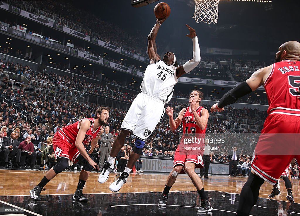 Gerald Wallace #45 of the Brooklyn Nets shoots past Joakim Noah #13 and Marco Belinelli #8 of the Chicago Bulls during the Game Seven of the Eastern Conference Quarterfinals during the 2013 NBA Playoffs at the Barclays Center on May 4, 2013 in the Brooklyn borough of New York City.