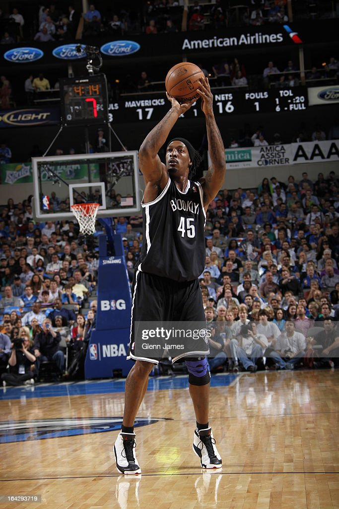<a gi-track='captionPersonalityLinkClicked' href=/galleries/search?phrase=Gerald+Wallace&family=editorial&specificpeople=202117 ng-click='$event.stopPropagation()'>Gerald Wallace</a> #45 of the Brooklyn Nets takes a shot against the Dallas Mavericks on March 20, 2013 at the American Airlines Center in Dallas, Texas.